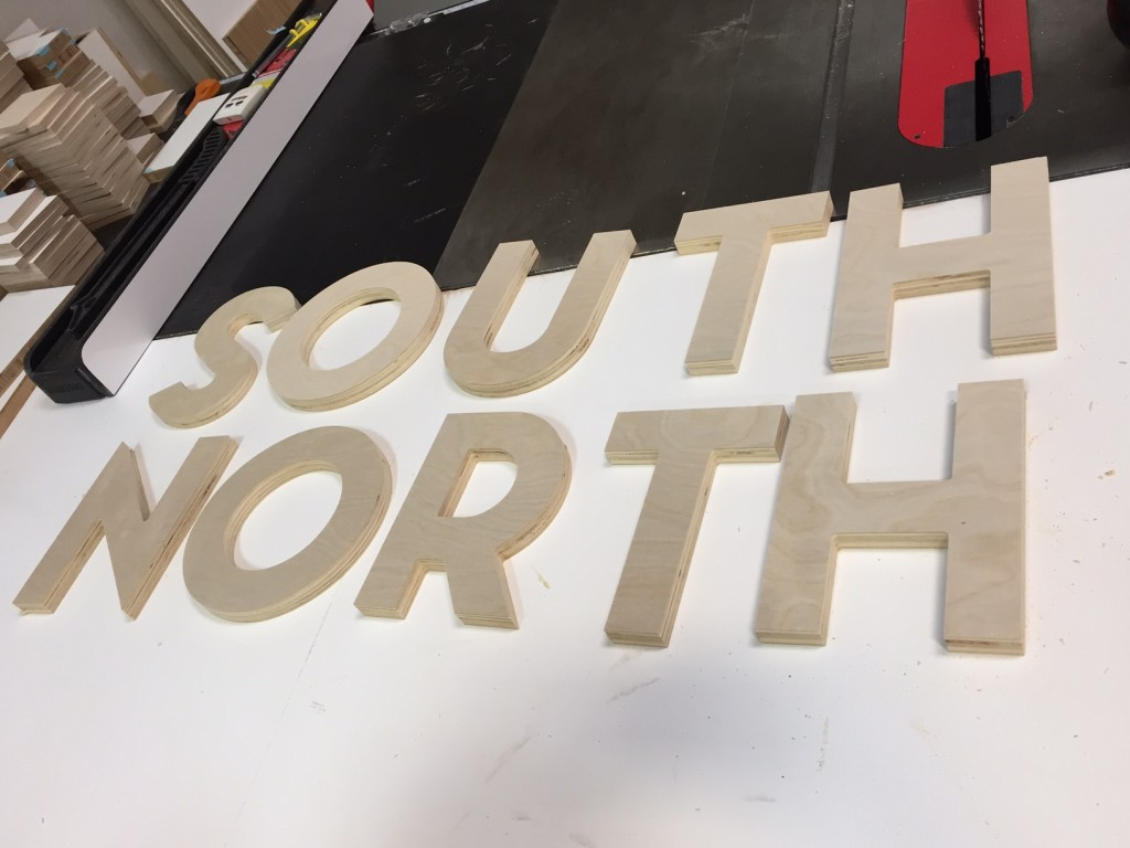 desert-trip-wood-print-south-north-event-wood-signage